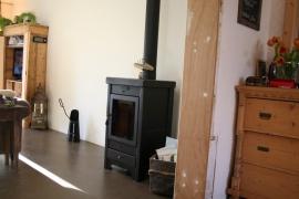 Verner hout cv kachel in nieuwe aanbouw
