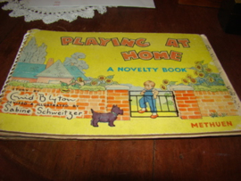 Playing  at home door Enid Blyton