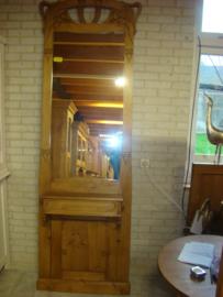 Langwerpige spiegel met lade.