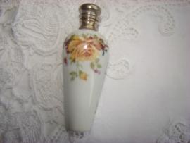 Porceleinen parfumflesje met okergeel roosje.    Verkocht.