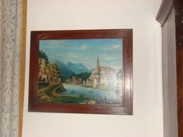 Oud schilderij met landschap.