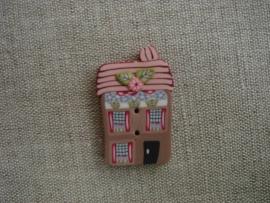 Knoopje huis met rose dakje