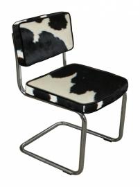 Stoel Carol  in zwart met wit koeienhuid