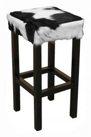 Barkruk, in zwart met wit koeienhuid