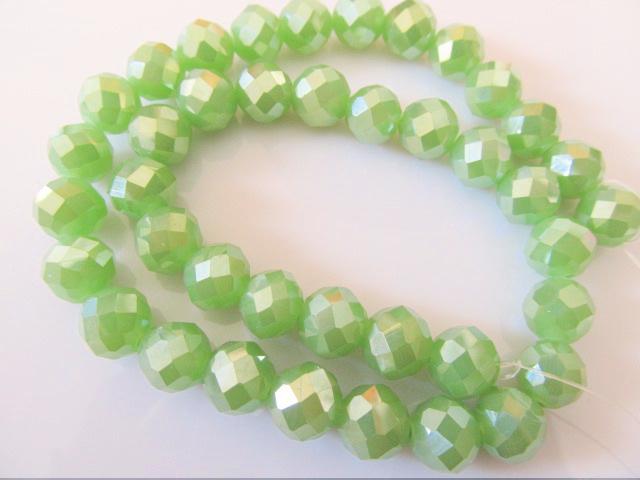 Kristalglas kraal rond groen facet 9.5x8.5 mm