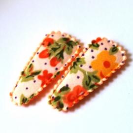 1 kniphoesje oranje gebloemd (3,5)