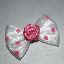 Roze polkadot strikje met roos 1 stuks