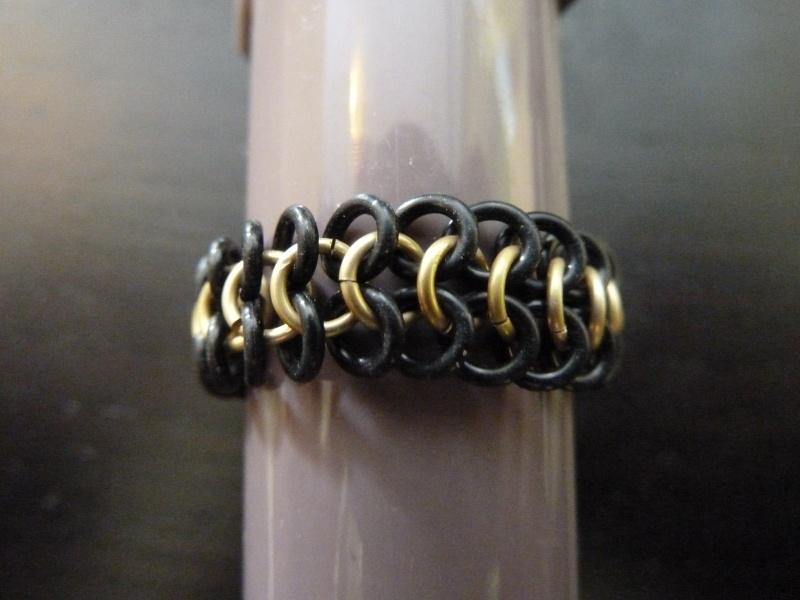 european 4in1 ring zwart/goud
