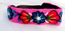 Roze haarband met bloemen