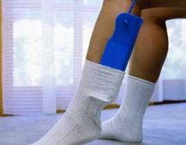 Sokaantrekker, de Sock-Assist, met 2 touwen