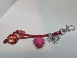 Zilverkleurig musketonhaakje met roze/oranje glaskralen