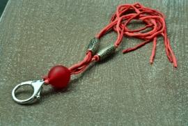 Rood keycord met holle glaskraal