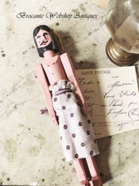 Pink wooden doll