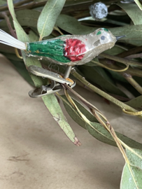Old glass bird for in the tree