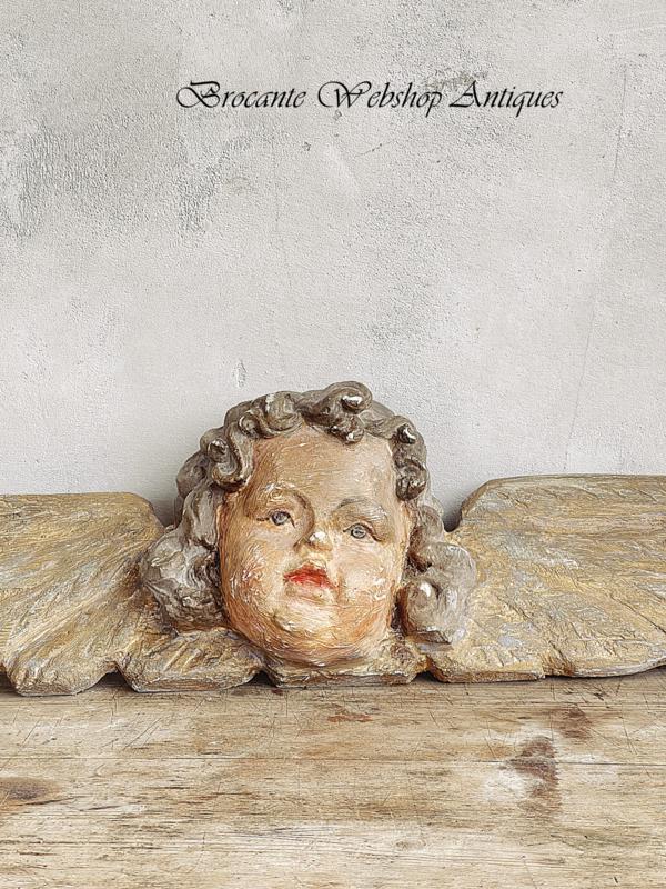 Oud houten putti