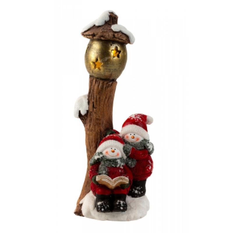 Sneeuwpoppen met lantaarn