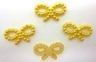 Strikjes goud geel  10 voor€ 0,25