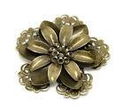 Bronskleurig metalen bloem.  Per stuk € 1,00