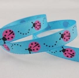 Blauw met roze lieveheersbeestjes.  per meter