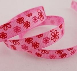 Roze met roze rode bloemen. per meter