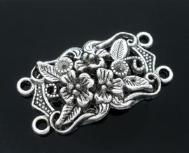 Zilver met bloemen.  36 x19 mm.  Per stuk