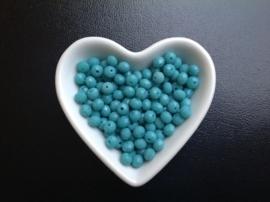 Groenblauw.   6 x 5 mm.  25 voor