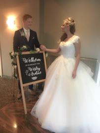 Sticker 'Welkom op de bruiloft van...' groter