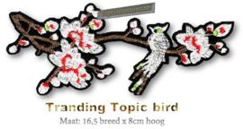 Applicatie bloemen met vogel
