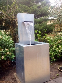 Fountain with leaden spout, with lovely flowing waters,