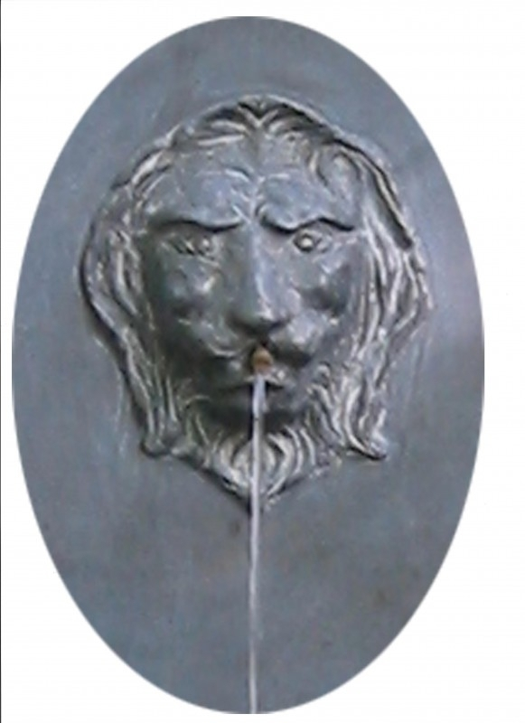 Lead lions head, Also for a cozy water fountain.