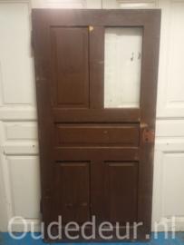 nr. 1317 oude brede deur met een paneel en een glasvak