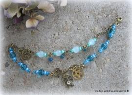 Armbandje Exo-a-1 goudkleurig met bedeltjes en kralen in blauw, turquoise en blauw/groen