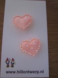 Zalm roze hartje met witte stipjes