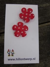 Rood bloemetje met witte stippen