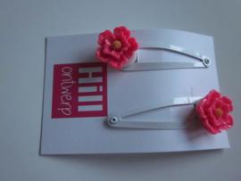 Witte knipjes met roze bloem