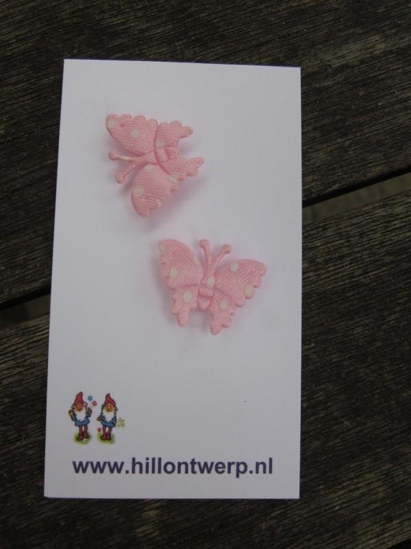 Roze vlindertje met witte stippen