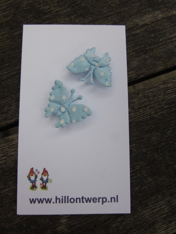 Licht blauw vlindertje met witte stippen