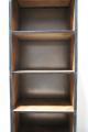 Hoge smalle boekenkast metalen frame houten planken industrieel stoer vintage landelijk