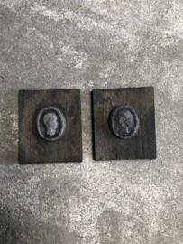 Set van 2 wandpanelen ornamenten vergrijsd hout beton kopjes hoofdjes landelijk stoer sober medaillon