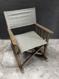 Stoere schommelstoel stoel fauteuil klapstoeltje landelijk grijs lichtgrijs grey houten frame linnen stoffen zitting
