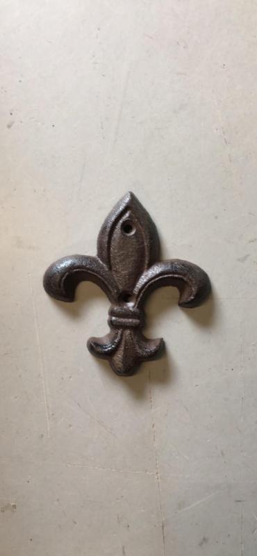 Gietijzeren ornament Franse punt lelie muuranker bruin landelijk brocant