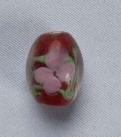 Rode glaskraal met bloem