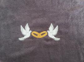 Badjasset met duiven en ringen