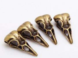 Birdhead skull - Brons