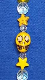 Schedel geel met mini ster