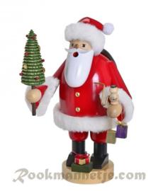 Kerstman met boompje groot 36cm