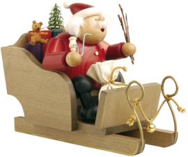 Kerstman in de slee 18cm