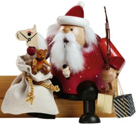 Kerstman met zak 15cm