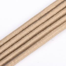 1 meter rond elastisch koord van rubber voorzien van een laagje stof 2mm Tan