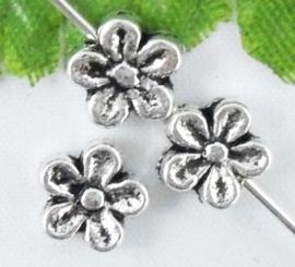 15 x  Tibetaans zilveren bloem kraal 7 x 3,5mm gat: 1mm